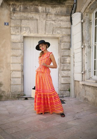 How to wear: orange vertical striped maxi dress, black leather flat sandals, beige straw tote bag, black straw hat