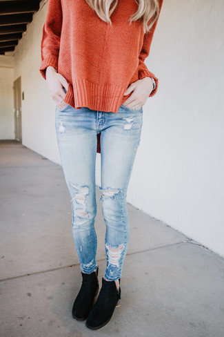 How to wear: orange oversized sweater, light blue ripped skinny jeans, black suede chelsea boots, silver watch