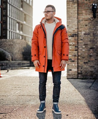 How to wear: orange parka, beige cable sweater, navy jeans, navy leather high top sneakers