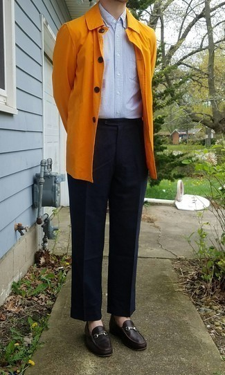 Mustard Raincoat with Pants Outfits For Men: Nail the classic look with a mustard raincoat and pants. Dark brown leather loafers are a fail-safe way to give an added touch of polish to this ensemble.