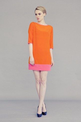 Wear an orange shift dress for a work-approved look. For the maximum chicness rock a pair of navy leather pumps.