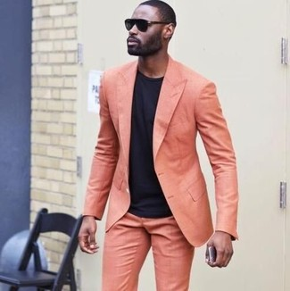 How to wear: orange suit, black crew-neck t-shirt, black sunglasses
