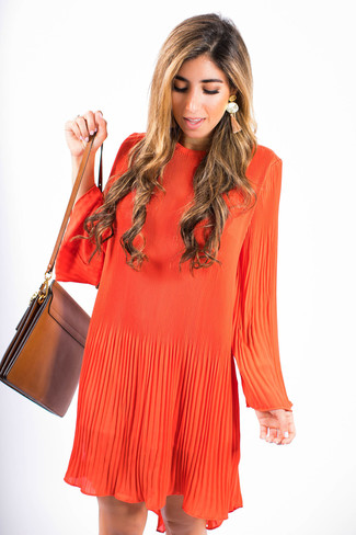 How to wear: orange swing dress, brown leather crossbody bag, orange earrings