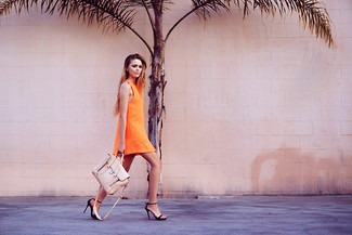 Wear an orange tank dress for an unexpectedly cool ensemble. Take a classic approach with the footwear and choose a pair of black leather pumps. Clearly, you're looking at a great idea for a warm summertime afternoon.