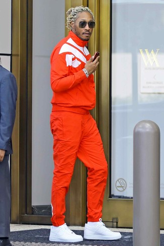 Future wearing Orange Track Suit, White Leather Low Top Sneakers, White Socks