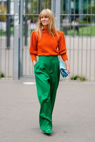 How to wear: orange turtleneck, green wide leg pants, green suede pumps, light blue leather clutch