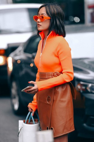 How to wear: orange zip neck sweater, tobacco leather pencil skirt, white leather tote bag, orange sunglasses