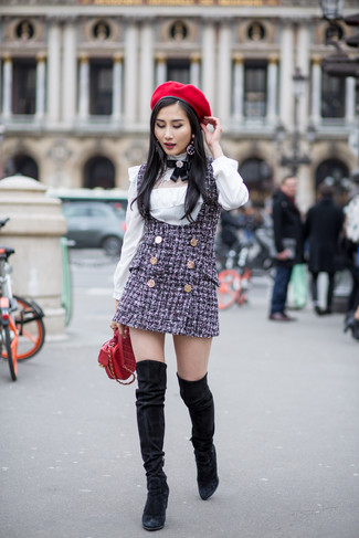 How to wear: navy tweed overall dress, white long sleeve blouse, black suede over the knee boots, red quilted leather crossbody bag