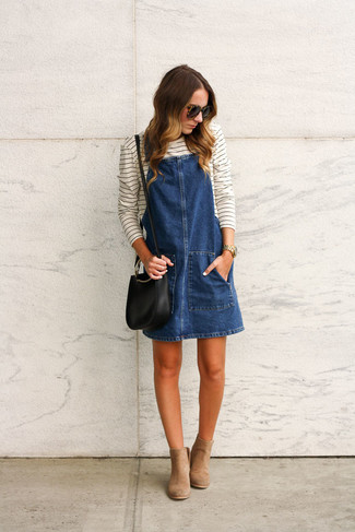 How to wear: navy denim overall dress, white and black horizontal striped long sleeve t-shirt, tan suede ankle boots, black leather crossbody bag