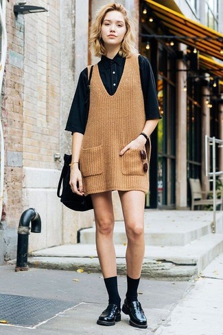 How to wear: tan knit overall dress, black denim short sleeve button down shirt, black leather loafers, black suede bucket bag