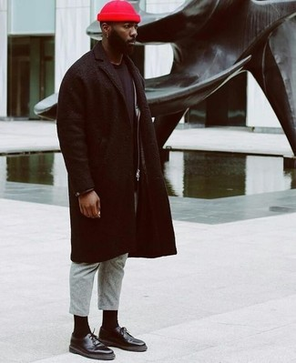 Pair a black overcoat with grey wool dress pants for a classic and refined silhouette. For something more on the daring side to finish off this ensemble, opt for a pair of black leather derby shoes.