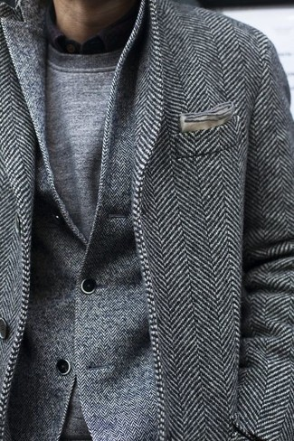 How to wear: grey herringbone overcoat, grey herringbone wool blazer, grey crew-neck sweater, black long sleeve shirt