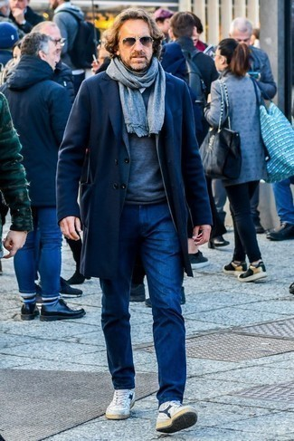 How to Wear a Charcoal Crew-neck Sweater For Men: The versatility of a charcoal crew-neck sweater and navy jeans means you'll have them on permanent rotation. Not sure how to finish off? Complement this getup with a pair of white and navy leather high top sneakers to change things up a bit.