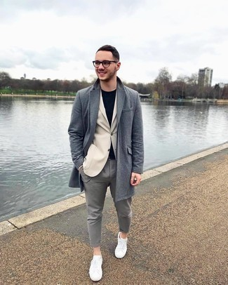 White Canvas Low Top Sneakers Outfits For Men: This combo of a grey overcoat and grey chinos looks considered and immediately makes any gent look cool. Finishing off with a pair of white canvas low top sneakers is a simple way to add a more laid-back aesthetic to this look.