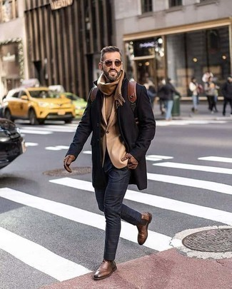 Brown Sunglasses Outfits For Men: If you're a jeans-and-a-tee kind of dresser, you'll like this basic yet casually stylish combination of a black overcoat and brown sunglasses. To bring an extra dimension to your getup, introduce brown leather chelsea boots to your outfit.