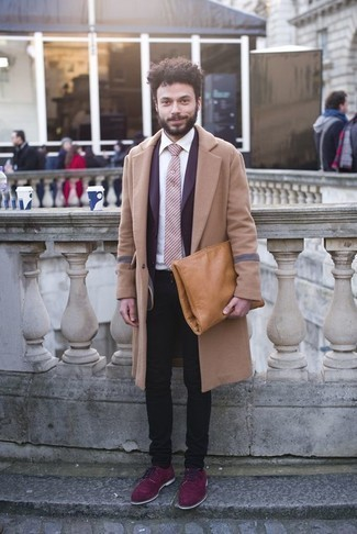 How to Wear Black Jeans In Cold Weather For Men: This combo of a camel overcoat and black jeans is irrefutable proof that a safe look doesn't have to be boring. Transform this ensemble with purple athletic shoes.