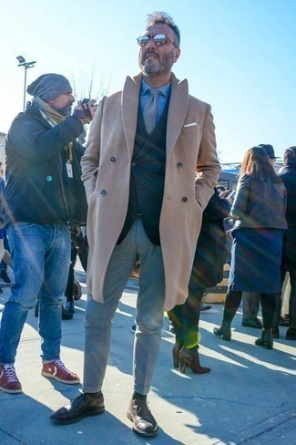 How to Wear a Camel Overcoat: A camel overcoat and grey chinos worn together are a match made in heaven for those who love elegant combinations. Dark brown leather brogues are an effective way to breathe an added dose of style into this ensemble.
