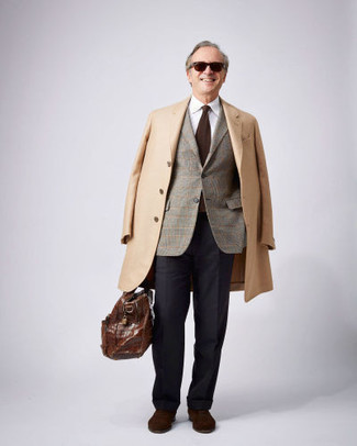 339 Cold Weather Outfits For Men After 50: This combination of a camel overcoat and black dress pants can only be described as ridiculously dapper and refined. Dark brown suede oxford shoes pull the look together. If you're often not sure how to dress your age, this ensemble is a practical illustration.