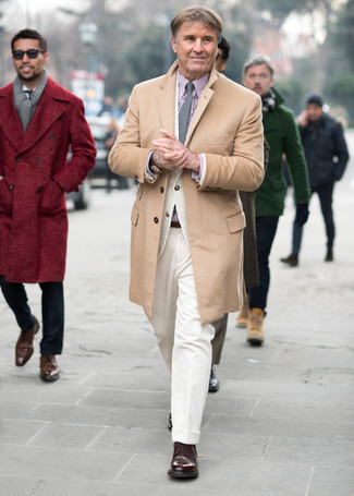 Camel Overcoat Outfits: This pairing of a camel overcoat and white corduroy dress pants is a foolproof option when you need to look seriously sharp. Does this outfit feel too fancy? Invite dark brown leather derby shoes to change things up a bit.