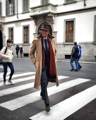 Camel Overcoat Outfits: This classy combo of a camel overcoat and charcoal dress pants is truly a statement-maker. Finishing off with a pair of dark brown suede chelsea boots is a surefire way to inject an easy-going feel into this getup.