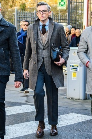 How to Wear a Grey Overcoat In Winter: A grey overcoat and navy dress pants are a savvy pairing that will get you a great deal of attention. Dark brown leather derby shoes are an effortless way to inject a touch of stylish effortlessness into this outfit. This ensemble is both neat and winter-friendly. Bingo!