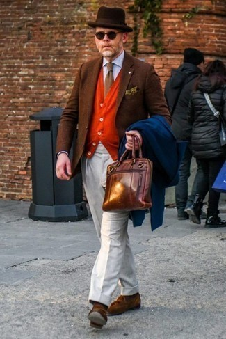 How to Wear a Dark Brown Wool Hat For Men: Consider teaming a navy overcoat with a dark brown wool hat to assemble a casual street style and functional getup. Want to dial it up when it comes to footwear? Complement this ensemble with brown suede tassel loafers. Overall, a nice idea when it comes to style for 40-year-old men.