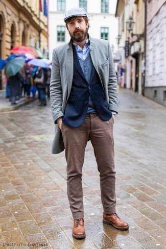 How to Wear a Grey Overcoat In Winter: This getup with a grey overcoat and brown chinos isn't a hard one to pull off and easy to adapt. All you need is a cool pair of tobacco leather casual boots to finish this ensemble. This outfit is truly a staple if you want to keep warm this winter season and look equally stylish.