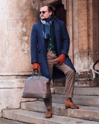 Bag Outfits For Men: You'll be amazed at how extremely easy it is for any man to put together a bold casual outfit like this. Just a navy overcoat and a bag. Brown suede casual boots will give some extra polish to an otherwise mostly dressed-down ensemble.