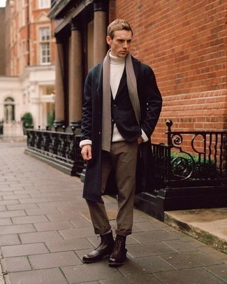 How to Wear Dark Brown Leather Brogue Boots: A black overcoat and brown chinos paired together are a match made in heaven for those who prefer casually smart outfits. All you need is a pair of dark brown leather brogue boots. If you often wonder how to dress age-appropriately, this pairing is a vivid example.