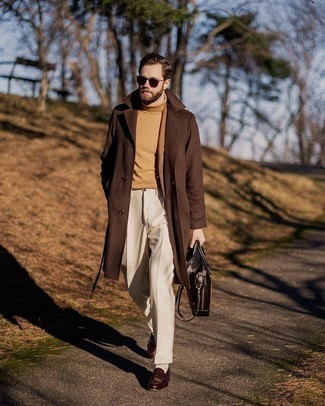 Bag Outfits For Men: For relaxed dressing with a street style take, dress in a brown overcoat and a bag. Let your sartorial prowess truly shine by finishing off this outfit with dark brown leather loafers.