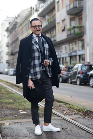 How to Wear a Black Waistcoat: This pairing of a black waistcoat and charcoal chinos couldn't possibly come across as anything other than outrageously dapper and polished. A pair of white low top sneakers will effortlesslly play down an all-too-dressy outfit.