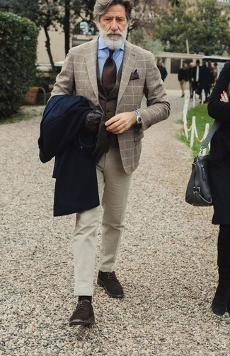 How to Wear a Dark Brown Waistcoat: A dark brown waistcoat and beige dress pants are absolute staples if you're picking out a dapper wardrobe that holds to the highest men's style standards. Tone down the formality of your getup by sporting a pair of dark brown suede derby shoes.