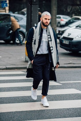 How to wear: navy overcoat, navy wool bomber jacket, grey print crew-neck t-shirt, navy chinos