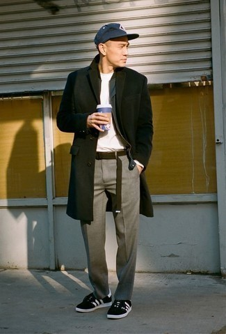How to Wear Black and White Suede Low Top Sneakers For Men: This combination of a black overcoat and grey chinos is a safe bet when you need to look sharp but have no extra time to dress up. Feeling creative? Tone down this look by finishing off with black and white suede low top sneakers.