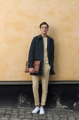 Men's Looks & Outfits: What To Wear In Cold Weather: For a casually stylish getup, make a navy and green plaid overcoat and yellow chinos your outfit choice — these two pieces fit wonderfully together. A pair of white canvas low top sneakers easily bumps up the wow factor of your look.