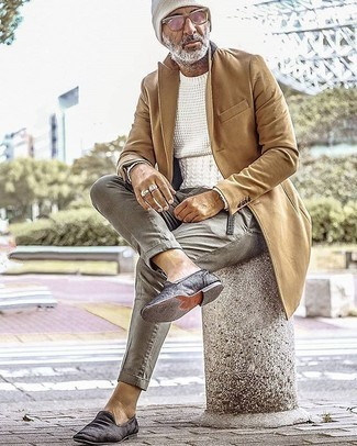 White Beanie Outfits For Men: A camel overcoat and a white beanie are bona fide staples if you're planning an off-duty wardrobe that matches up to the highest menswear standards. Complement this ensemble with black velvet loafers for a masculine aesthetic.