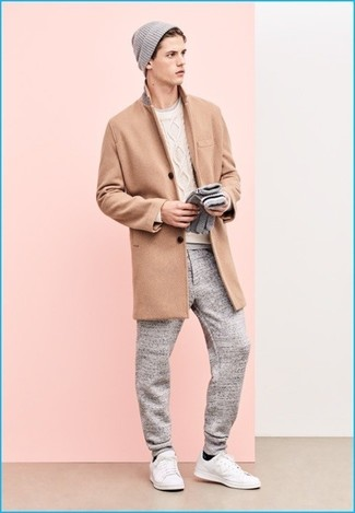 How to wear: camel overcoat, white cable sweater, grey crew-neck t-shirt, grey sweatpants