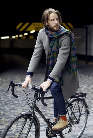 How to wear: olive overcoat, navy cable sweater, white check dress shirt, navy jeans
