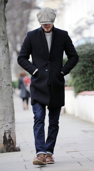 David Beckham wearing Black Overcoat, White Cable Sweater, Navy Jeans, Brown Leather Casual Boots