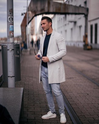 How to wear: grey overcoat, navy cable sweater, light blue ripped jeans, white leather low top sneakers