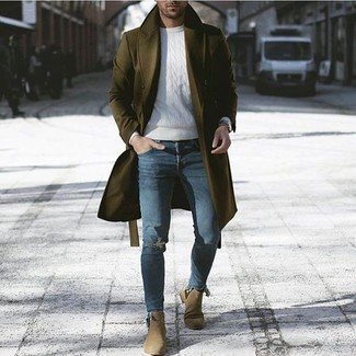 How to wear: olive overcoat, white cable sweater, blue ripped skinny jeans, olive suede chelsea boots