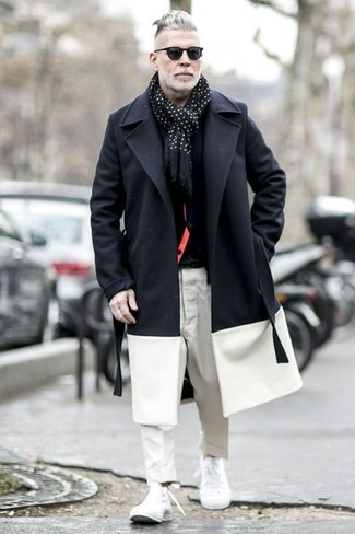 How to wear: black and white overcoat, black cardigan, black crew-neck t-shirt, white chinos