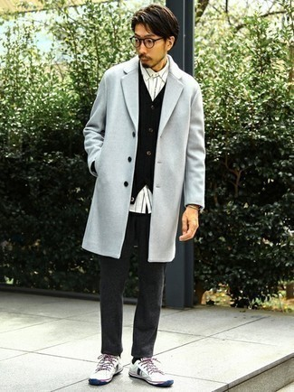 Black Cardigan Outfits For Men: Try pairing a black cardigan with charcoal wool chinos for a simple look that's also well put together. To infuse a fun vibe into your ensemble, introduce a pair of white and navy canvas low top sneakers to the mix.
