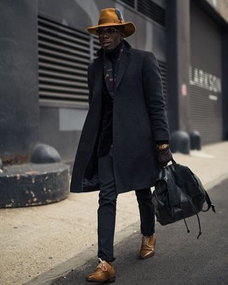 How to wear: black overcoat, black chinos, brown leather derby shoes, black leather backpack