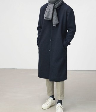 How to Wear a Grey Scarf For Men: To put together a casual getup with an edgy take, try pairing a navy overcoat with a grey scarf. If not sure as to what to wear in the shoe department, stick to white low top sneakers.