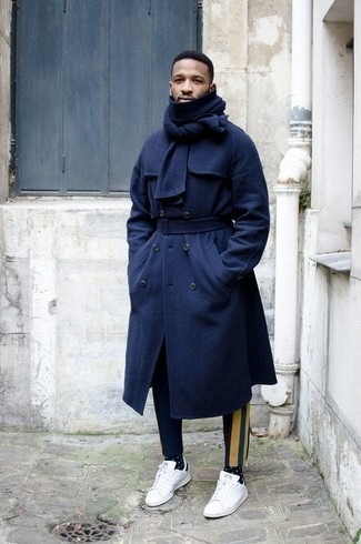 How to Wear Navy Print Chinos: Marry a navy overcoat with navy print chinos if you're aiming for a proper, stylish outfit. Introduce a pair of white and black leather low top sneakers to the equation to keep the ensemble fresh.