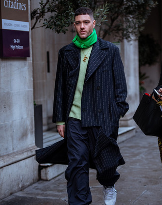 How to wear: navy vertical striped overcoat, green crew-neck sweater, navy cargo pants, white athletic shoes