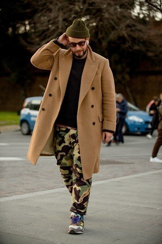 Camel Overcoat Outfits: This pairing of a camel overcoat and olive camouflage cargo pants is a must-try semi-casual look for any modern gentleman. Don't know how to finish? Add white and brown athletic shoes to the mix for a more casual spin.