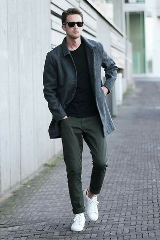 How to wear: charcoal overcoat, black crew-neck sweater, dark green chinos, white low top sneakers