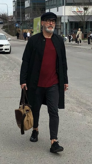 How to wear: black overcoat, burgundy crew-neck sweater, black chinos, black leather low top sneakers